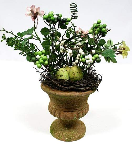 Vase with bird nest eggs and berries floral arrangement