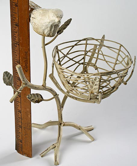 Off white metal branch with bird nest and