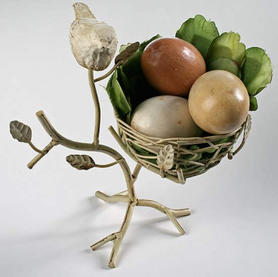 Off white metal branch with bird nest and table