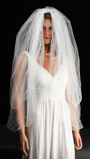 Ivory two tier bridal veil with details pearls and floral