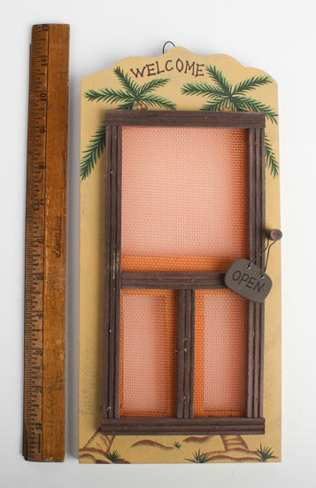 Small old fashioned wooden screen door with palm tree