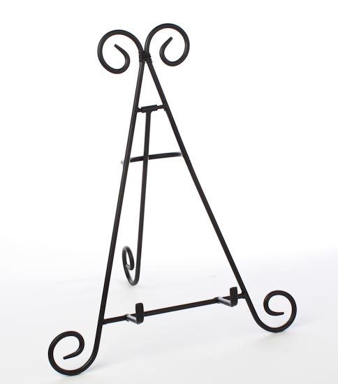 black wrought iron display easel decorative plates and bowls