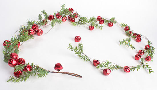 Red jingle bells and artificial pine garland holiday