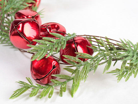red jingle bells and artificial pine garland holiday florals