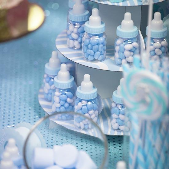 Blue baby bottle shower favors it 39 s a boy theme baby for Baby bottle decoration ideas
