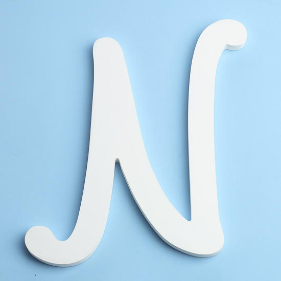 White brush font wood letter n word and letter cutouts