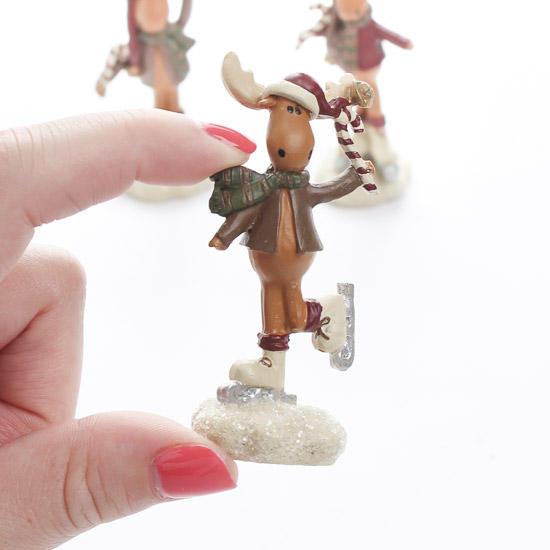 Miniature ice skating moose figurines table decor