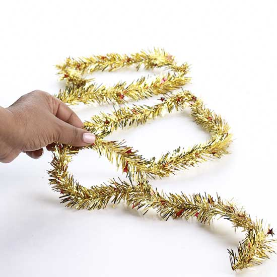 Gold tinsel garland with red stars christmas garlands