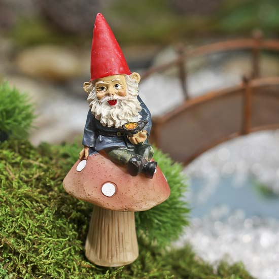 Gnome In Garden: Fairy Garden Gnome Upon Mushroom With Pick