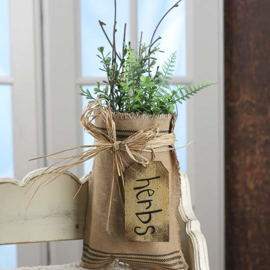 Artificial herb and natural twig filled burlap bag wall for Twig decorations home