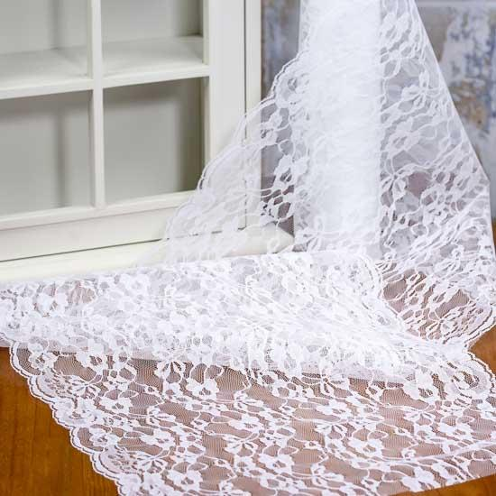 The crisp white color of the Prima Table Runner from Heritage Lace goes well with all kinds of home décor. The delicate embroidery and hand-crocheted trim add personality and character to this linen.