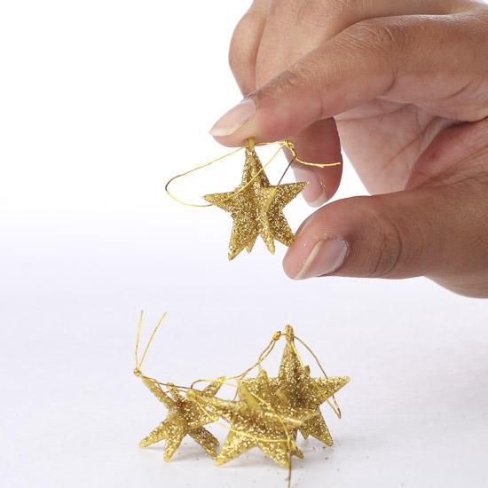Miniature gold glittered dimensional star ornaments