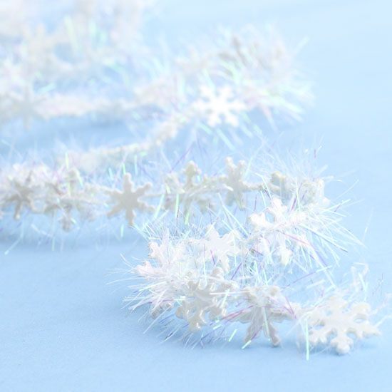Miniature white iridescent tinsel snowflake garland