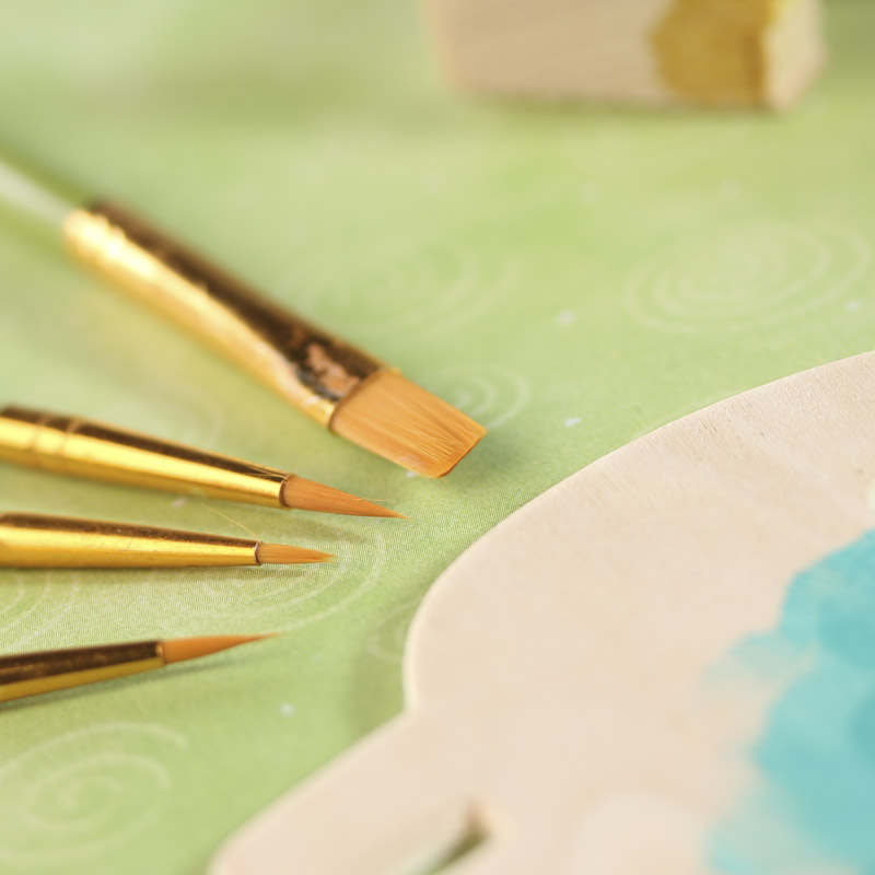 Golden nylon paint brushes and accessories