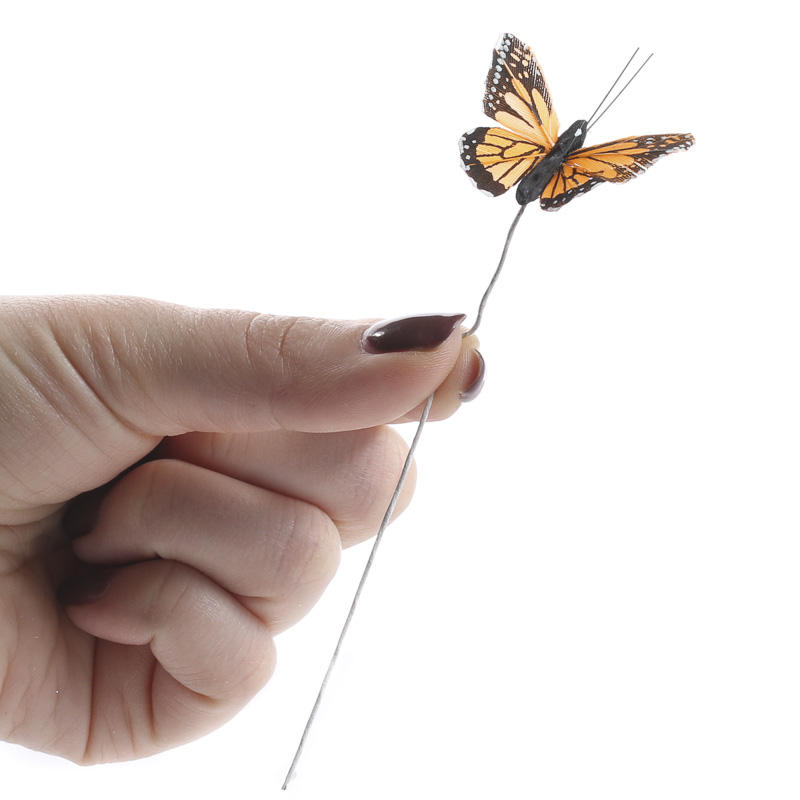 Natural feather artificial monarch butterflies what 39 s for Synthetic feathers for crafts