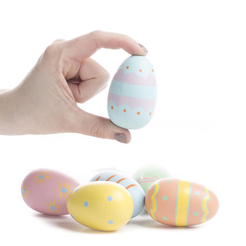 Painted wooden easter egg spring and easter holiday crafts for Wooden eggs for crafts