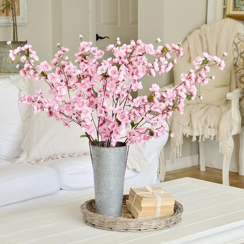 pink artificial plum blossom spray
