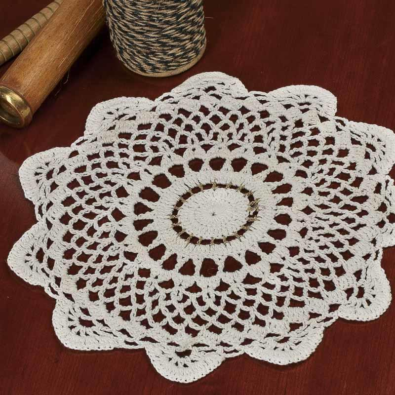Round gold accented cream crocheted doily crochet and