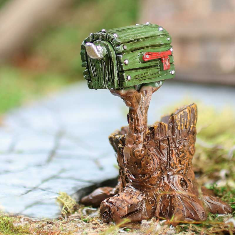 Miniature tree stump holding mailbox fairy garden for Little fairy mailbox
