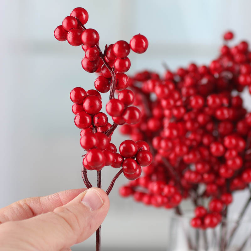 red artificial berry picks