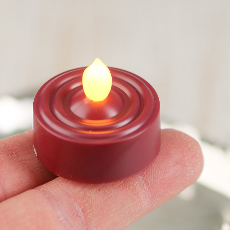 burgundy battery operated flickering tea light candle candles and. Black Bedroom Furniture Sets. Home Design Ideas