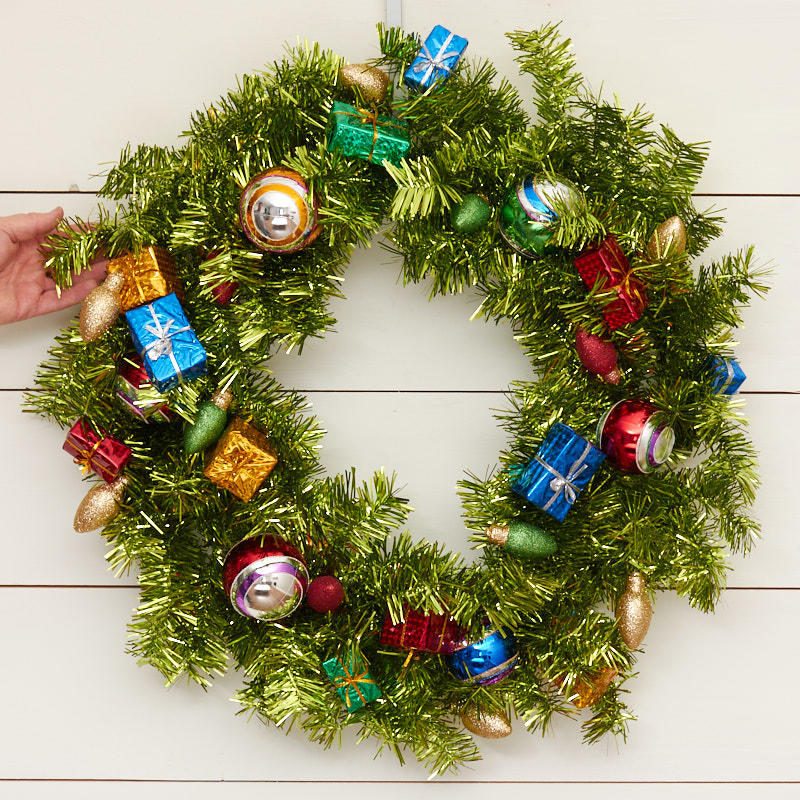 Large green tinsel and ornaments wreath christmas