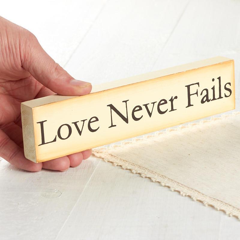 Primitive Quot Love Never Fails Quot Chunky Block Sign Table