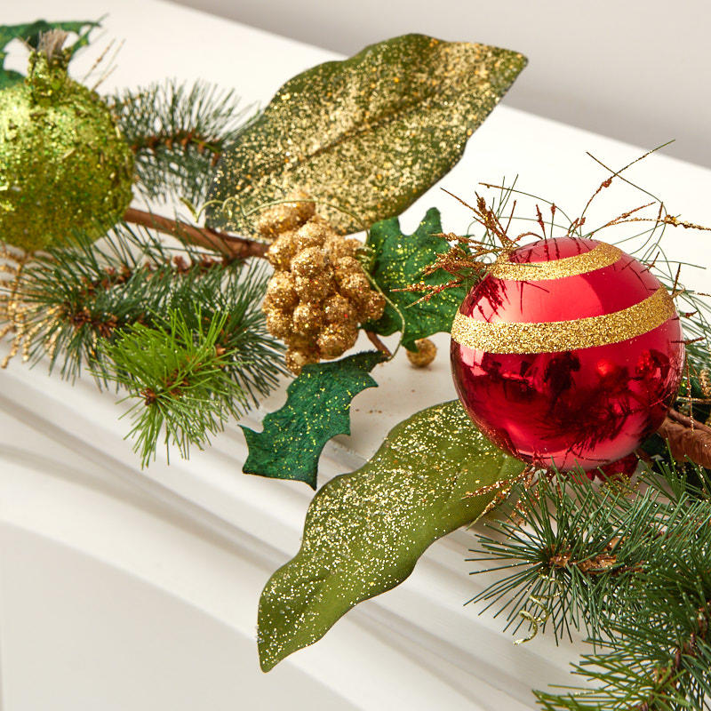 Glittered Christmas Ornaments And Artificial Pine Garland